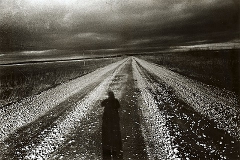 untitled (self portrait with road) by daido moriyama