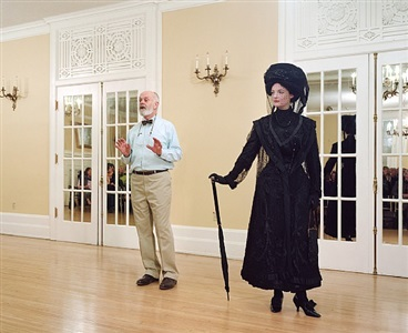 ivan sayers, costume historian, lectures at the university women's club, vancouver, 7 december 2009. virginia newton-moss wears a british ensemble c. 1910, from sayers' collection by jeff wall