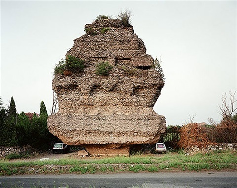 lovers parking beneath a pyramidal tomb of the second century a.d., via appia antica, rome, november 1990 by joel sternfeld