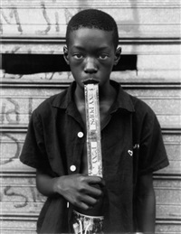 a boy eating a foxy pop by dawoud bey