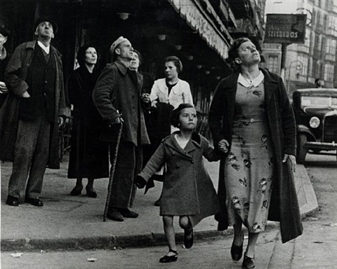 running for shelter during the air raids, spain, bilbao, 1937 by robert capa