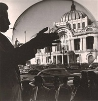 boy with balloon against bellas artes, mexico city by nacho lopez