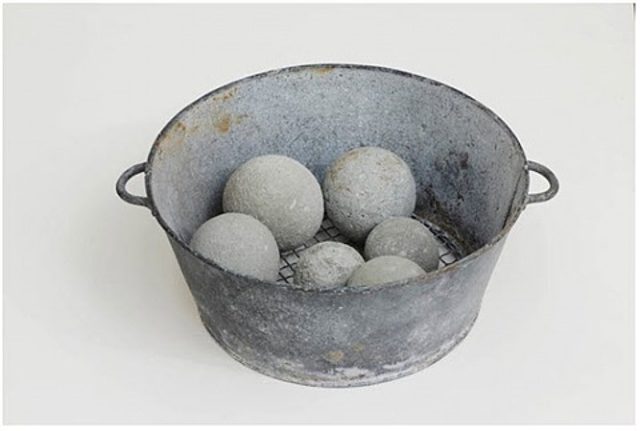 untitled (metal colander bowl with 6 dumbballs) by david ireland