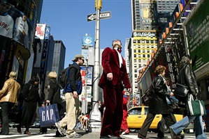 the man in the red vevlet suit. times square now. by landon nordeman