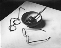 mondrian's glasses and pipe by andré kertész