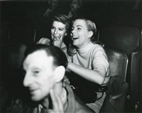 girls laughing at a movie by weegee