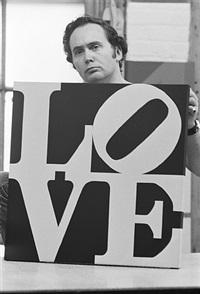 robert indiana holding love, coenties slip studio, new york city by william john kennedy