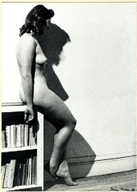 assia—profile posing naked sitting on the edge of a library, 1938 by dora maar