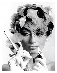 anouk aimée and cigarette holder, paris (vogue) by william klein