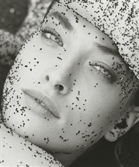 tatjana with black sand - close up, hawaii by herb ritts