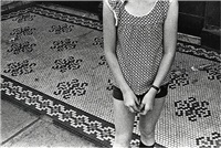 girls arms and tile floor. 1974. by mark cohen