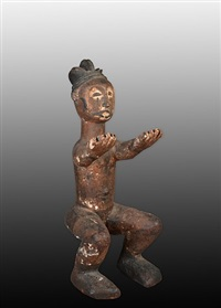 idoma seated figure by unknown