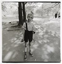 child with toy hand by diane arbus