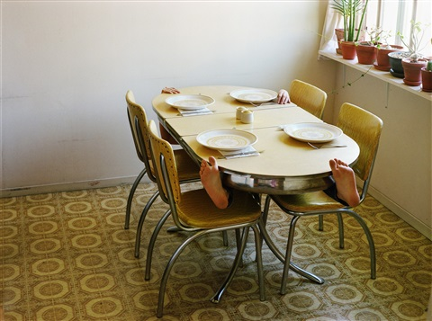 hanging onto my kitchen table by lee materazzi