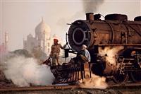 taj and train, agra, india, 1983 by steve mccurry