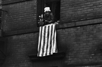 time of change (woman at window with american flag) by bruce davidson
