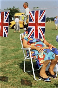 gb. england. sedlescombe. british flags at a fair. 1995-1999. by martin parr