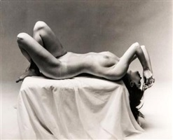 nude laying on pedestal, by andre de dienes