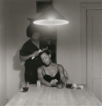 kitchen table series: woman brushing hair by carrie mae weems