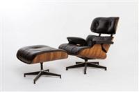 eames lounge and ottoman in rosewood and black leather for herman miller by charles and ray eames