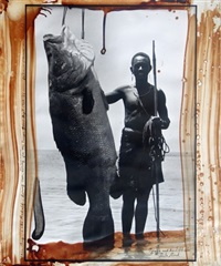 nguya and his 201 lb. nile perch, alia bay, march by peter beard