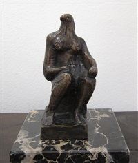 small seated figure by henry moore