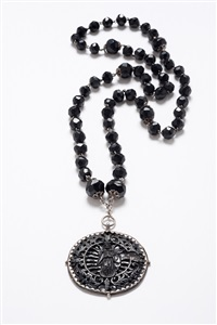 rosary with medal showing the immaculate conception by unknown