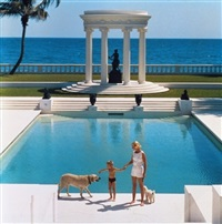 guest and her son in front of their grecian pool by slim aarons