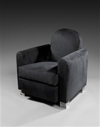 beautiful club armchair with rounded back by jacques adnet