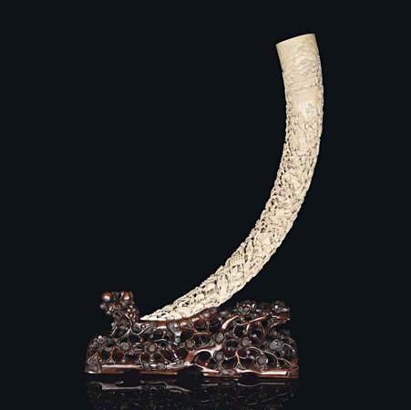 A large carved and pierced ivory tusk